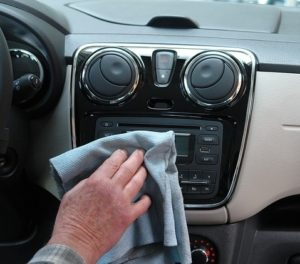 cleaning the car interior with a cloth