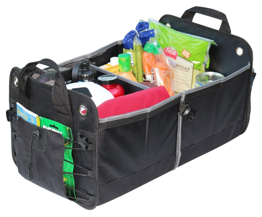 grocery and sports equipment in a car trunk organizer