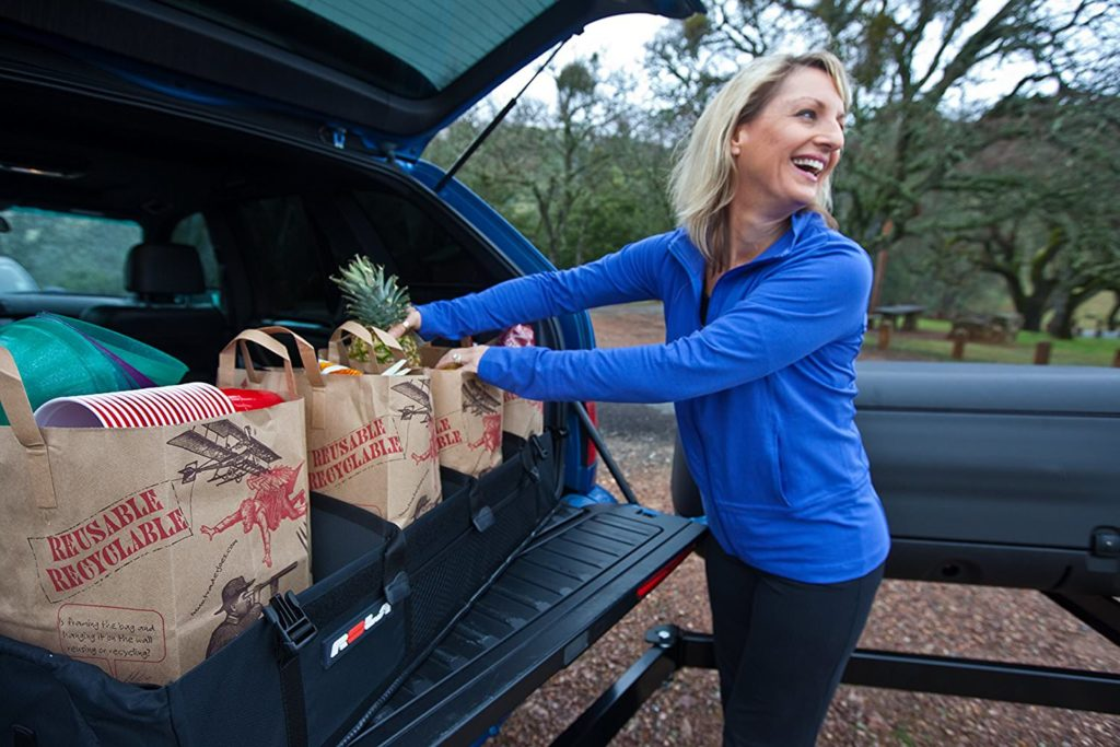 Woman putting groceries in the hatch of her car