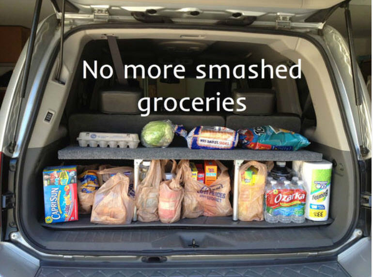 home-made pop up shelf car organizer with groceries in back of car
