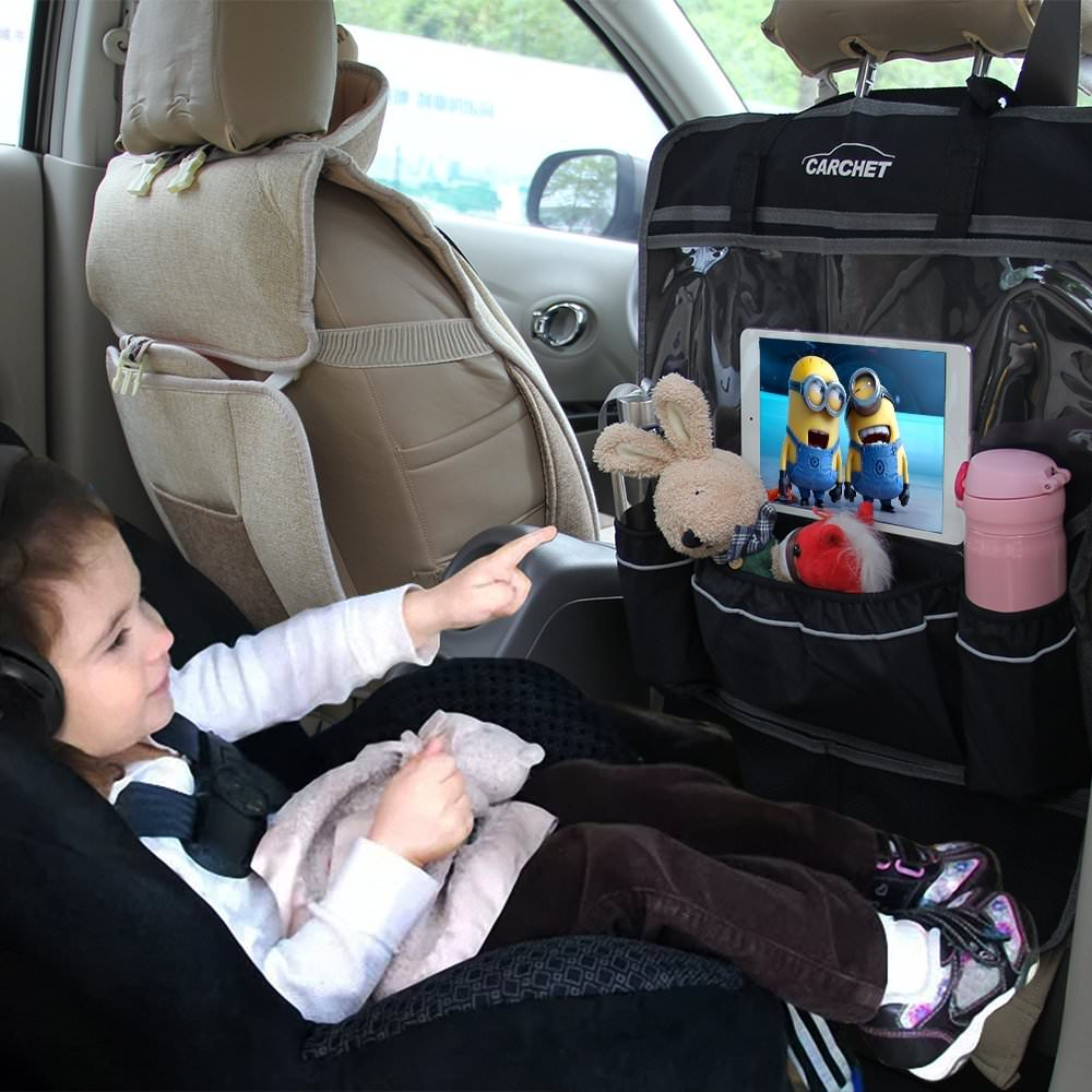 child playing with a tablet holder hooked to seat