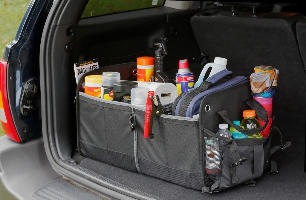 car trunk organizer sitting in an SUV holding tools and auto supplies