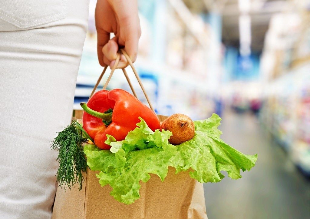 paper grocery bag with lettuce, herbs, pepper and potatoes