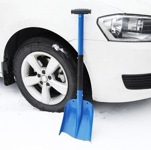 Blue Portable Snow Shovel by Cartman sitting next to a white car