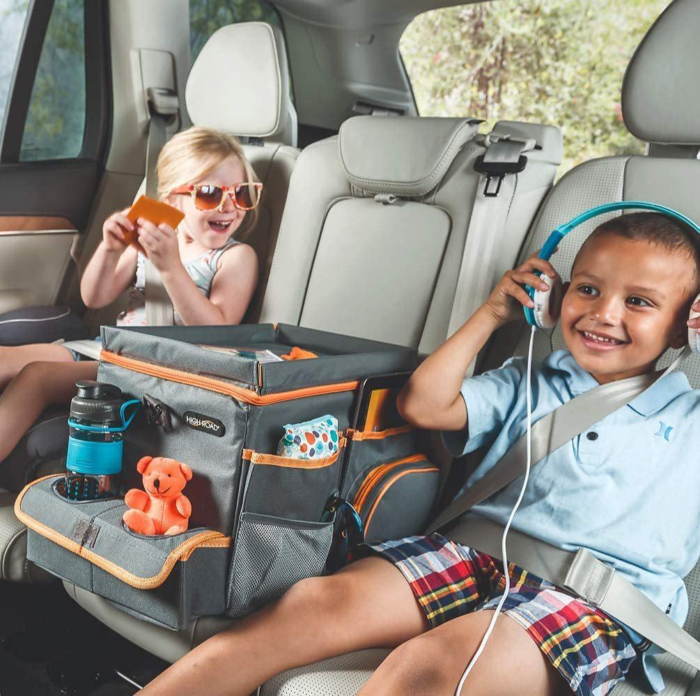 center seat organizer/cooler option with toys and children in the back seat