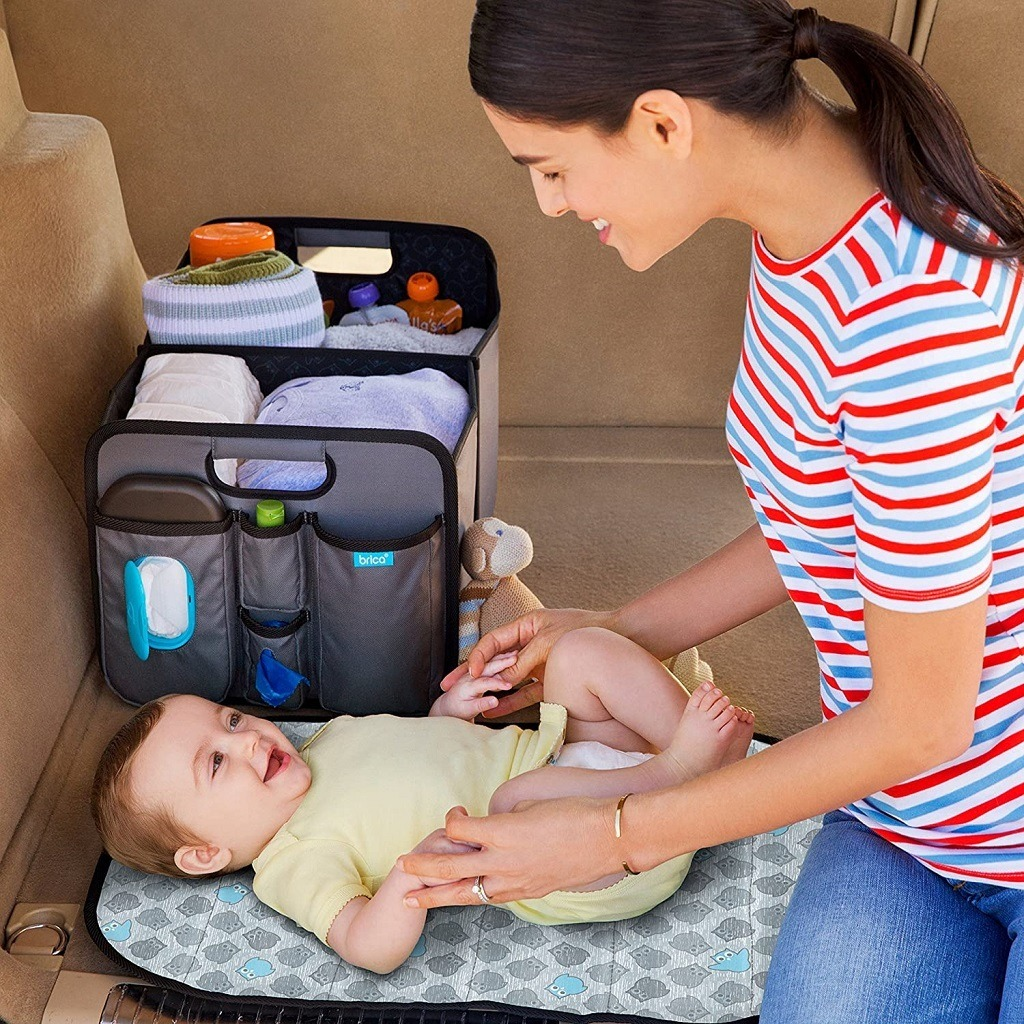 car organization product for baby shown with changing table and room for diapers, etc.