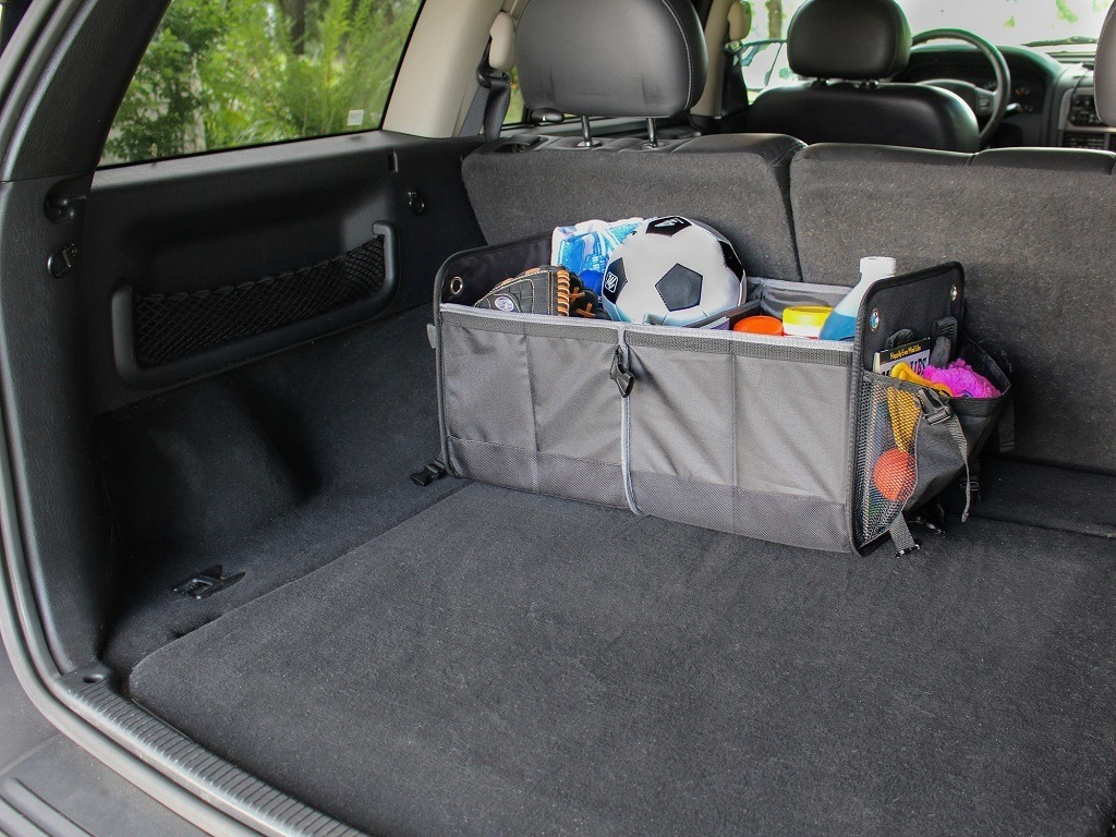 suv cargo storage organizer filled with sports gear and car accessories