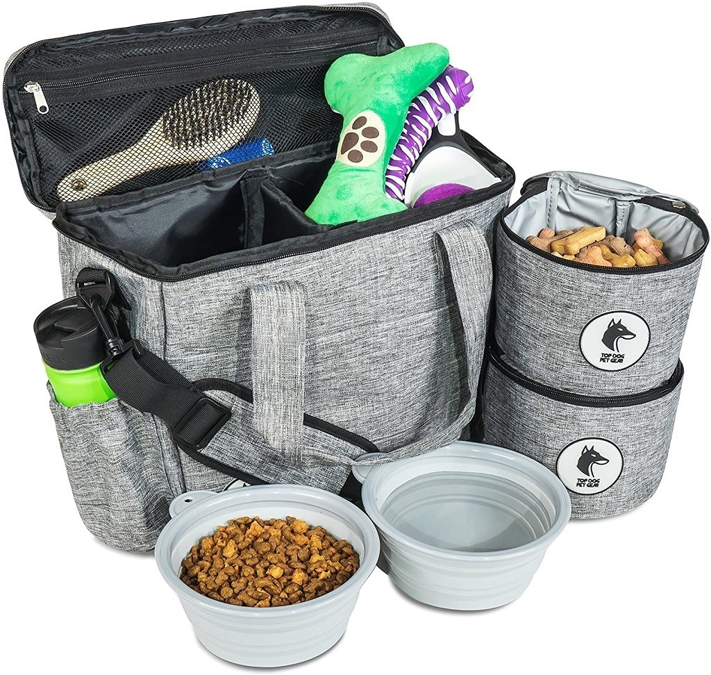 Grey Dog travel bag with food compartments and serving dishes filled with dog supplies