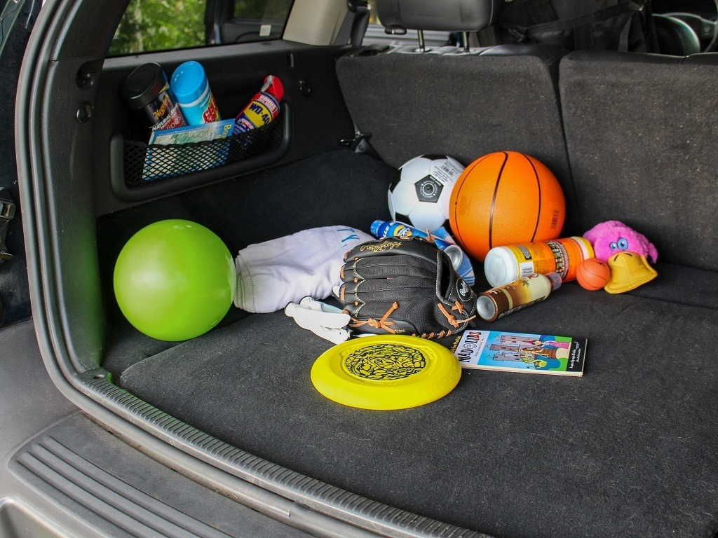 back of suv with toys scattered