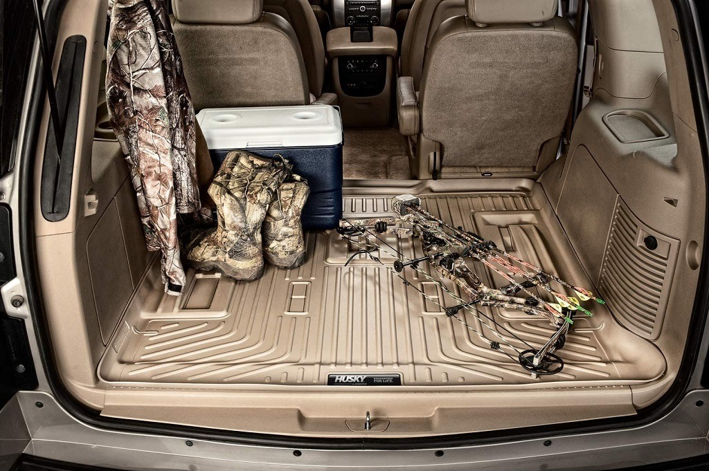 Clean Husky Cargo Liner inside an SUV with hunting gear