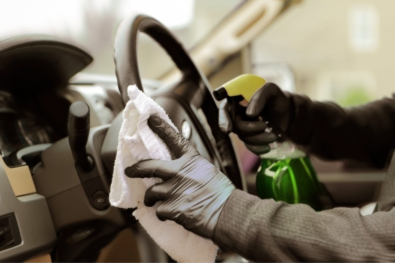 car cleaning supplies - hand cleaning the steering wheel